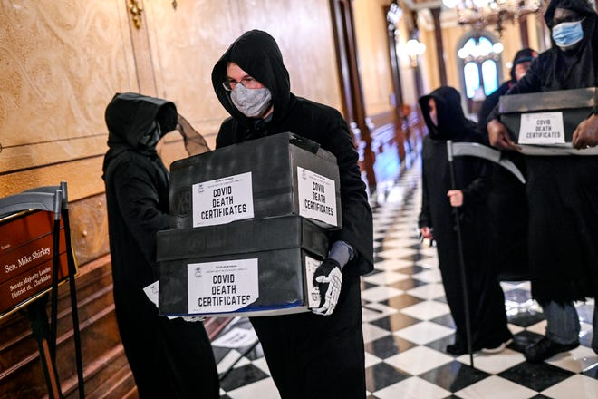 Experts say a coronavirus herd immunity strategy would be deadly. So did Grim Reapers at the Capitol.