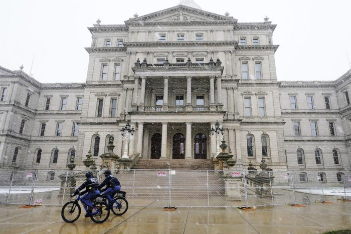 Photos: State capitols boarded up, fenced off, patrolled by troops