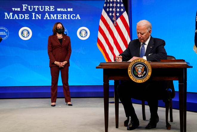 Signing 'Buy American' order, Biden pushes for urgent relief