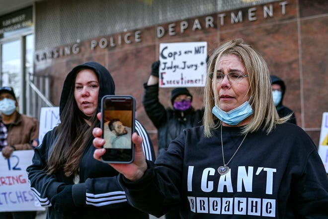 Anthony Hulon's sisters join protestors in demanding officers be fired, charged with crimes in asphyxiation death