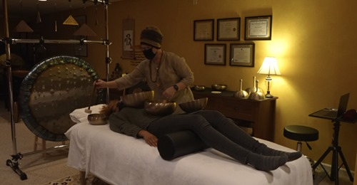 With singing bowls, gongs and tuning forks, Lansing sound therapist brings relief from anxiety