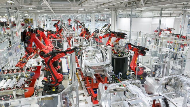 Tesla reportedly cuts production of Model 3 electric car at California factory amid semiconductor shortage