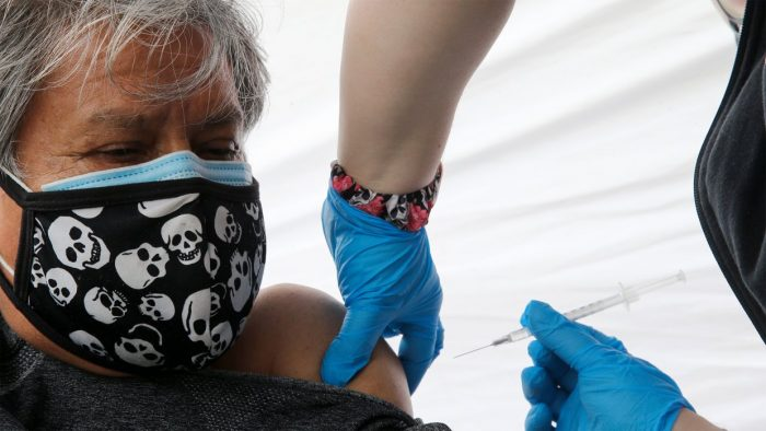 Immigrants crucial to vaccinating US, but gaps remain