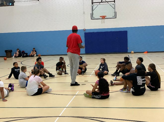 How a free basketball camp for kids aims to curb Lansing gun violence